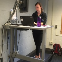 Natalie transcribing interviews while on the walkstation in Rosenau Hall.